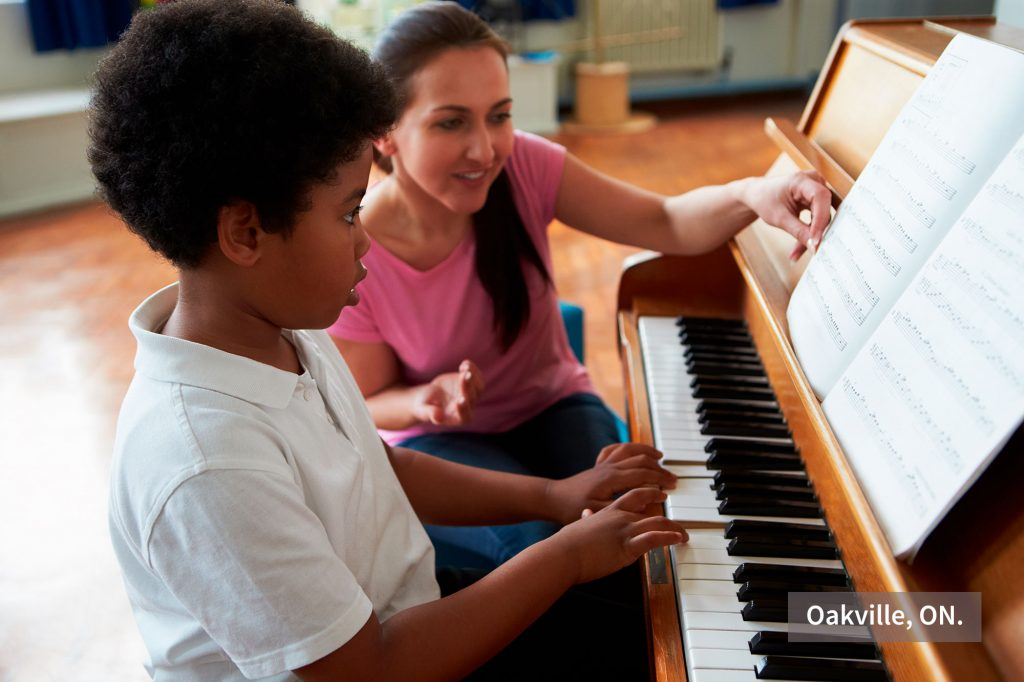 In-home music teacher teaching piano